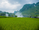 Tranquil rice paddies on the Vietnamese-side and imposing karst mountains on the Chinese-side of the border, taken from Ban Gioc, Cao Bang, Vietnam, on September 2015