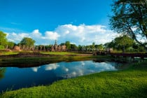 Moat and temple ruins, in Sukhothai Historical Park, Sukhothai, Thailand