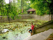 Marcos with the lily-filled pond at Dinh Thien Hoang Temple, in Ninh Binh, Vietnam, on September 2015