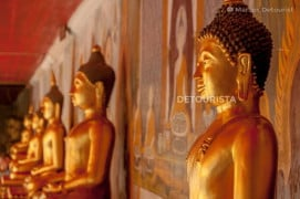 Row of golden sitting Buddhas at the temple complex of Wat Doi Suthep, Chiang Mai, Thailand