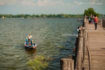 Local rowing a boat beside Ubein Bridge in Amarapura, Greater Mandalay, Myanmar