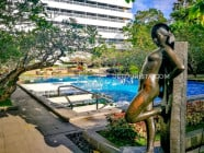 Metal sculptural pieces at the poolside